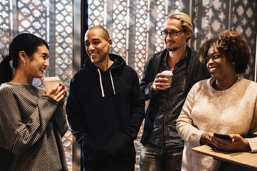 People in break room smiling